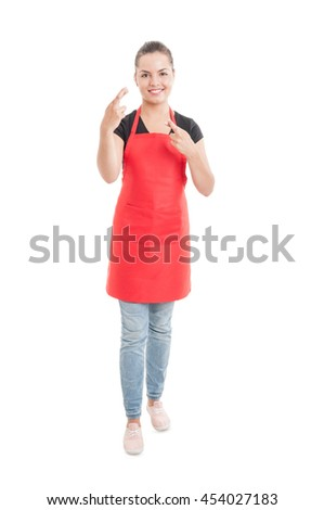 Full body of pretty hypermarket employee doing double luck gesture isolated on white background - stock photo