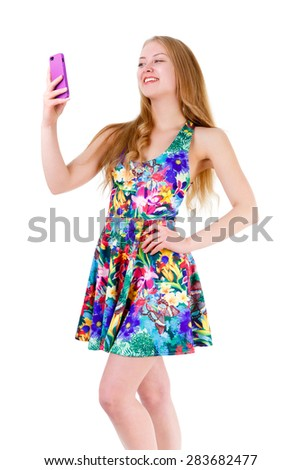 Full body of smile teenager girl read sms in a smart phone, isolated on white background. Positive human emotion, facial expression - stock photo