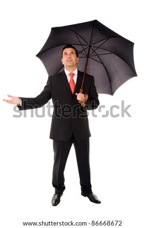 Full body of young business man with umbrella and checking the rain on white - stock photo