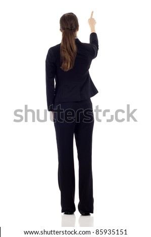 Full body of young business woman pointing at something in her back, isolated on white background - stock photo