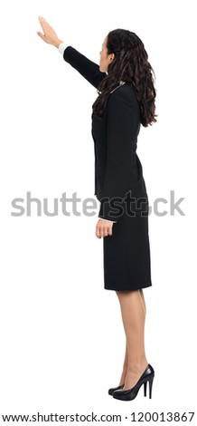 Full body of young business woman pointing at something in her back, isolated over white background - stock photo