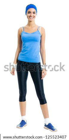 Full body of young cheerful smiling woman in sports wear, isolated over white background - stock photo