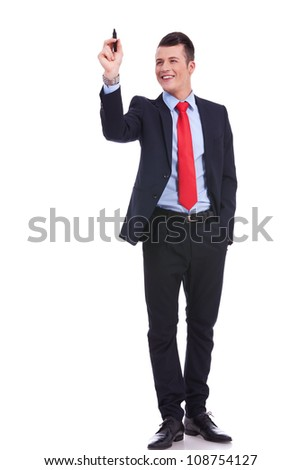 full body picture of a business man writing with marker isolated on white background - stock photo