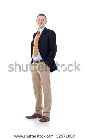 full body picture of a smiling business man standing with hands in pockets - stock photo