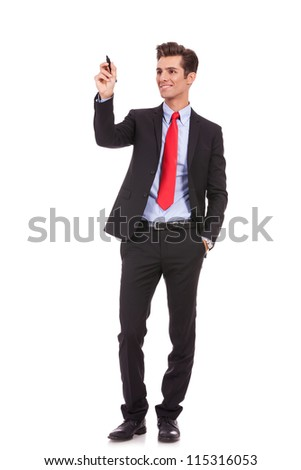full body picture of a smiling business man writing something with a marker - stock photo