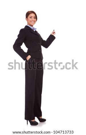 full body picture of a smiling business woman presenting something on the back with hand holding marker. Isolated over white background - stock photo