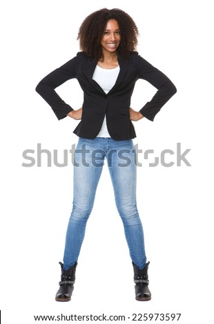 Full body portrait of a happy african american woman with hands on hip - stock photo