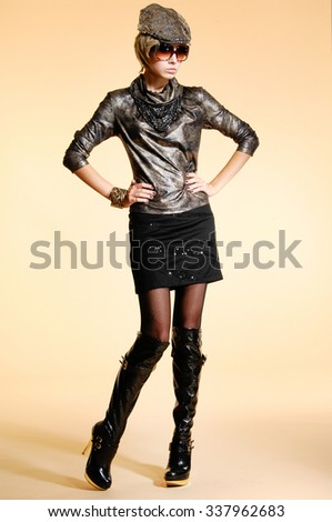Full body portrait of a styled professional model on light background - stock photo