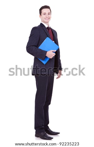 full body portrait of a young business man with a blue clipboard over white background - stock photo