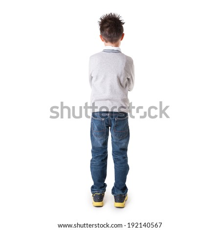 Full body portrait of eight year kid from behind against white background.  - stock photo