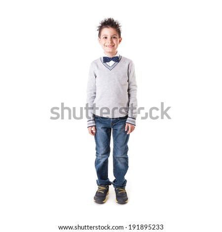 Full body portrait of eight year kid wearing papillon against white background.  - stock photo