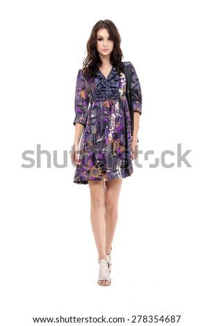 Full body portrait of girl walking in studio - stock photo