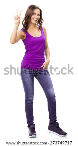 Full body portrait of happy smiling beautiful young woman in casual smart lilac clothing, showing two fingers or victory gesture, isolated against white background - stock photo
