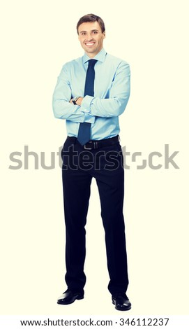 Full body portrait of happy smiling young business man - stock photo