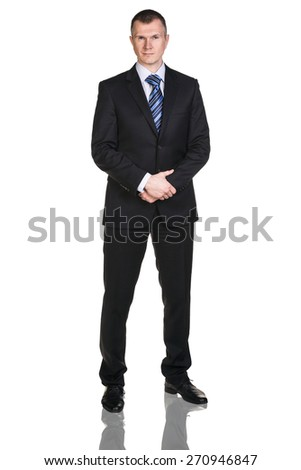 Full body portrait of serious business man, over white background - stock photo
