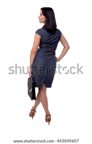 Full body portrait of shapely business woman in dress back view with portfolio, briefcase, isolated on white - stock photo