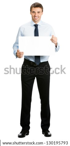 Full body portrait of smiling young business man showing blank signboard, isolated over white background - stock photo
