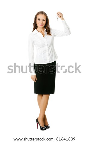 Full body portrait of young happy smiling business woman or real estate agent showing keys from new house, isolated on white background - stock photo