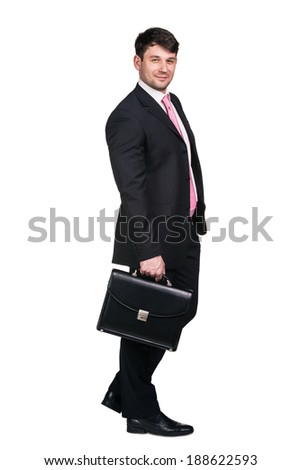 Full body portrait of young happy smiling cheerful business man, over white background - stock photo
