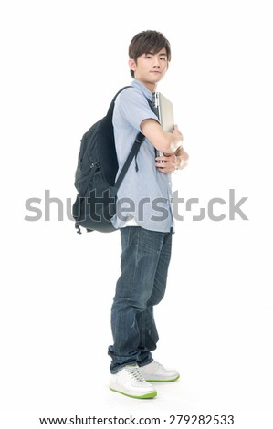 Full body portrait of young man standing man with backpack holding laptop - stock photo