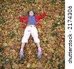 full body pose in in autumn leaves - stock photo