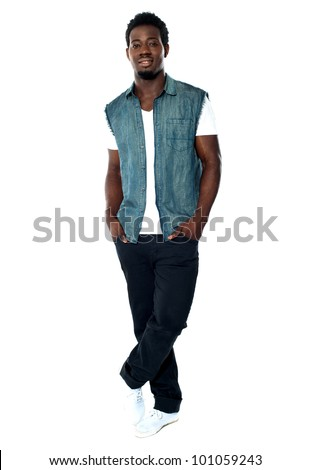 Full body pose of young african male model posing in casuals with legs crossed - stock photo
