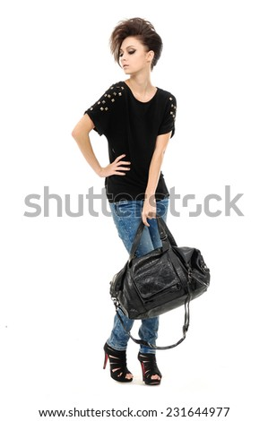 Full body Pretty model in jeans with bag against white background  - stock photo