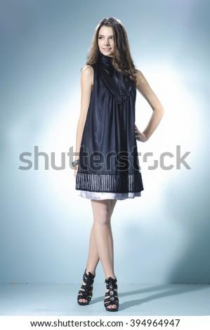 Full body shot of a beautiful vogue style girl posing - stock photo