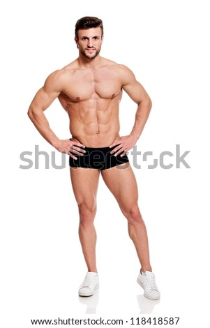 full body shot of a young handsome fit man, smiling, on white background - stock photo