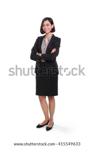Full body shot of confident Asian businesswoman standing with arms folded, isolated over white studio background - stock photo