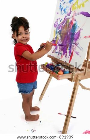 Full body shot of three-year-old girl painting. - stock photo