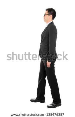 Full body side view of Asian business man walking, isolated on white background - stock photo