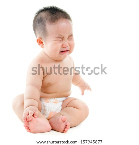 Full body upset Asian baby boy crying, sitting isolated on white background - stock photo