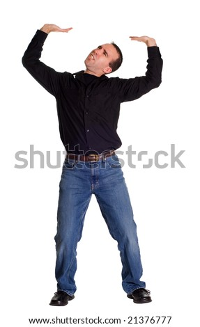 Full body view of a man pretending to hold up a heavy sign - stock photo