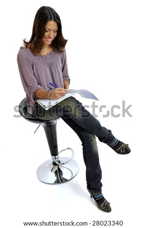 Full body view of young teacher or college student holding copybooks. Isolated on white background. - stock photo