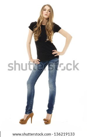 Full body young blonde woman in blue jeans posing on white background - stock photo