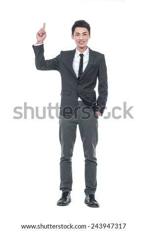 Full body young business man in a suit pointing with his finger - stock photo