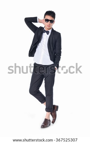 Full body young businessman in sunglasses standing  - stock photo