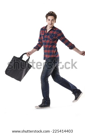 full body young businessman with his bag walking on white background - stock photo