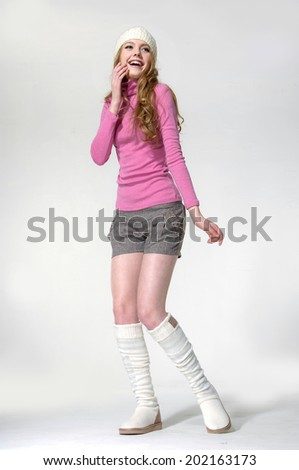 Full body young girl wearing a white beret in white boots posing - stock photo