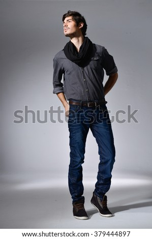 Full body Young handsome male in jeans posing  - stock photo