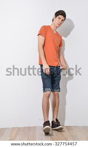 Full body young Man in Casual Clothes posing - stock photo