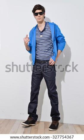 full body young man standing in sunglasses isolated. male model. - stock photo