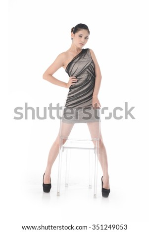 Full body young model in near chair posing - stock photo