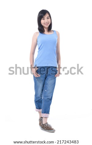 Full body young woman in casual clothes, relaxed pose, isolated over a white background. - stock photo
