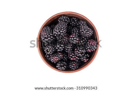 Full bowl of fresh blackberries isolated on white background top view - stock photo