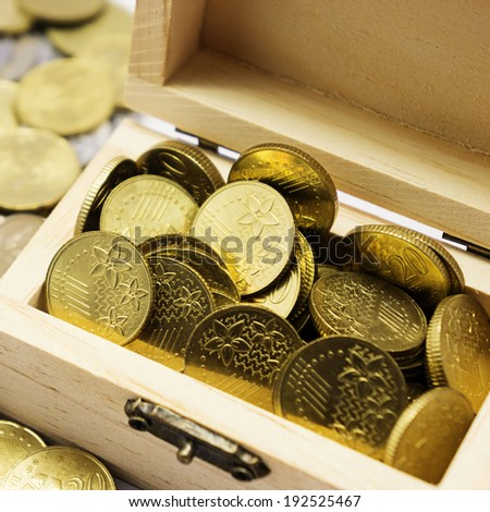 Full coins in the box - stock photo
