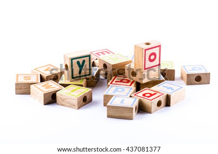 Full color Wooden toy blocks on white background - stock photo