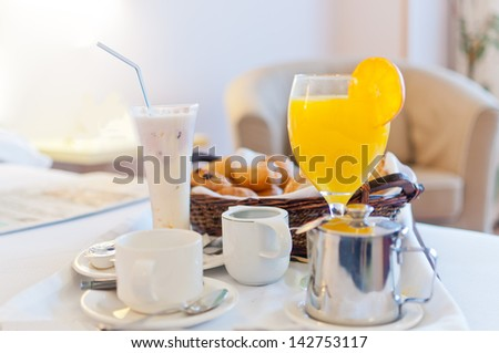 Full continental breakfast served in bed ready to take - stock photo