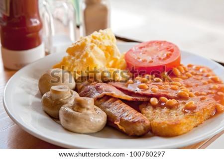 Full English Breakfast on Table - stock photo